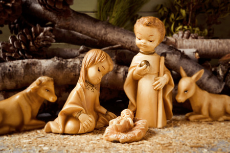 presepio: the holy family, the Child Jesus, the Virgin Mary and Saint Joseph, and the donkey and the ox in a rustic nativity scene Stock Photo