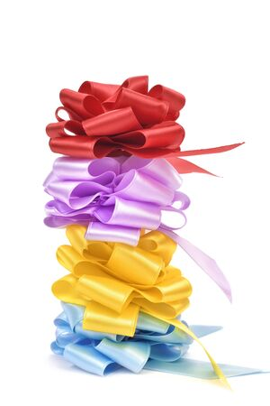 loopy: a stack of satin gift ribbon bows of different colors on a white background