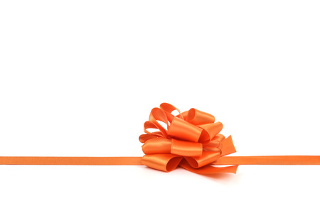 loopy: an orange satin gift ribbon bow on a white background, with a negative space
