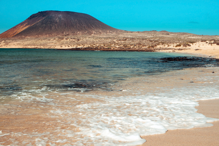 seawater: a view of La Francesa Beach in La Graciosa island, in the Canary Islands, Spain, with the Montana Amarilla mountain in the background