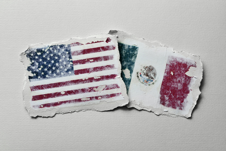 bilateral: the flag of United States and the flag of Mexico in two aged pieces of paper on an off-white background
