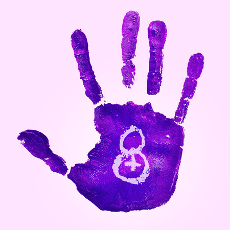 egalitarianism: a violet handprint and the number 8 for the womens day, observed in March 8, on a pink background