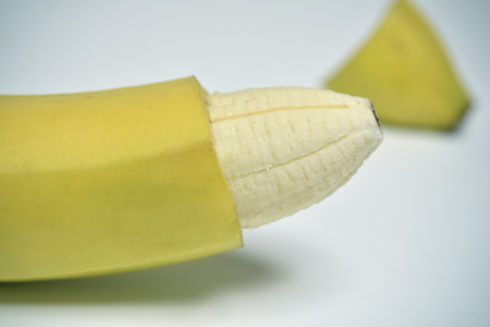 closeup of a banana with the skin of its tip removed depicting a circumcised male member Фото со стока - 72489930