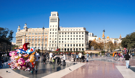 BARCELONA, SPAIN - DECEMBER 11, 2016: A view of the ambiance of Placa Catalunya in Barcelona, Spain, the square which is considered to be the city center, where some of the most important streets meet together