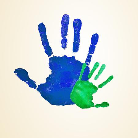 progeny: a blue handprint of an adult and a green infant handprint, depicting the idea of family, or the relationship of a father or mother and his or her son or daughter