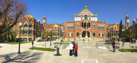 BARCELONA, SPAIN - MARCH 18, 2017: Visitors at the modernist complex of the Hospital de Sant Pau in Barcelona, Spain, which is part of the UNESCO World Heritage Site Works of Domenech i Montaner