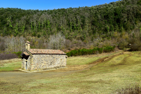 a view of the old small church dedicated to Saint Margaret in the crater of the Santa Margarida Volcano in the Garrotxa Volcanic Zone Natural Park, in Olot, Spain Banco de Imagens