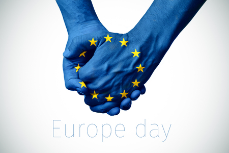fraternity: two persons holding hands patterned with the flag of the european community and the text europe day on an off-white background, with a slight vignette added