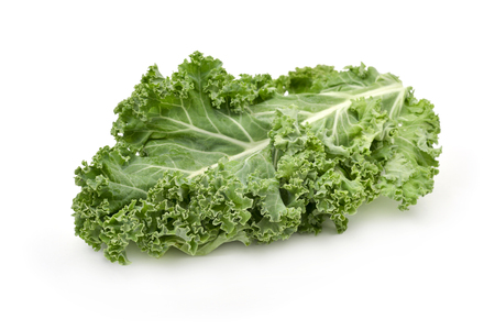 closeup of some leaves of kale on a white background
