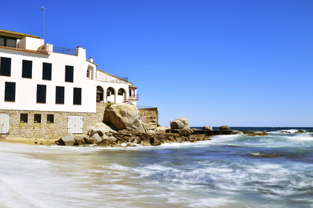 a view of the Malaspina Beach in Calella de Palafrugell, Costa Brava, Catalonia, Spain, with its characteristics white houses Stock Photo