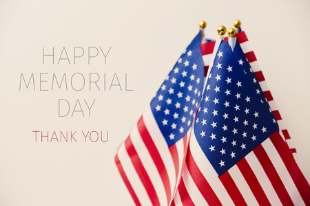 the text happy memorial day, thank you and some flags of the United States against a beige background