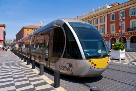 maritimes: NICE, FRANCE - JUNE 4, 2017: A tram passing through the Place Massena square in Nice, France. The Place Massena is the main public square in the famous city of the French Riviera