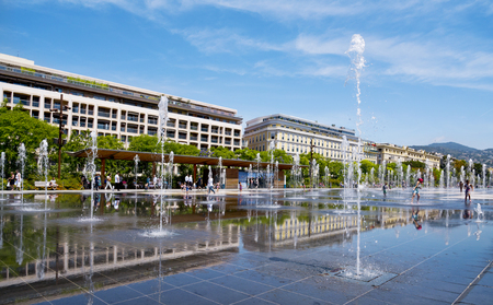 NICE, FRANCE - JUNE 4, 2017: A view of the reflecting pool of the Promenade du Paillon in Nice, France. This pool in the large public park has 128 water jets, that delight children Editorial