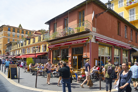 alpes maritimes: NICE, FRANCE - JUNE 4, 2017: A view of the busy ambiance in a street in the Vielle Ville, the Old Town, of this popular city in the French Riviera