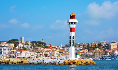 wanderlust: a panoramic view of the Vieux Port, the Old Port of Cannes, France, and Le Suquet district, the old town, in the background