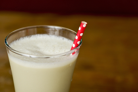 a glass of horchata, a summer typical drink of Valencia, Spain, on a rustic wooden table