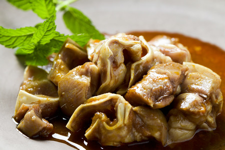spanish oreja de cerdo, a typical stew of pigs ear, served on a slate tray Stock Photo