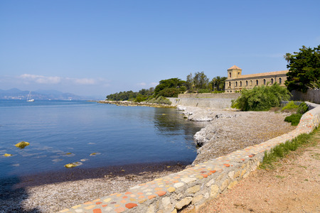 monastic: a view of the Lerins Abbey in the Saint-Honorat island, France, with the coast of Cannes in the background