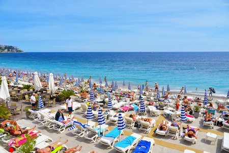 Attractive NICE, FRANCE   JUNE 4, 2017: People Sunbathing On The Beach In Nice