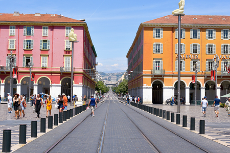 NICE, FRANCE - JUNE 4, 2017: A view of the Place Massena square in Nice, France, with the tramway rails in the foreground. This is the main public square in the famous city of the French Riviera Editorial