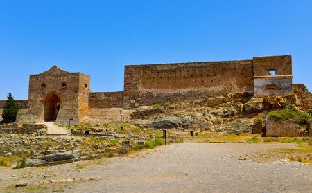 a view of the remains of the Citadel of Sagunto, Spain, in the top of a hill