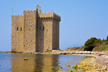 monastic: a view of the medieval fortified monastery of the Lerins Abbey in the Saint-Honorat island, France, surrounded by the Mediterranean sea