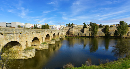 a view of the Puente Romano, an ancient Roman bridge over the Guadiana River, in Merida, Spain
