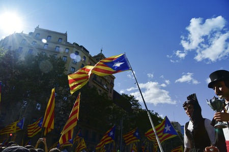 BARCELONA, SPAIN - SEPTEMBER 11, 2017: People in the Passeig de Gracia, in Barcelona, Spain, partaking in the rally in support for the independence of Catalonia, during its National Day