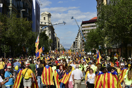 BARCELONA, SPAIN - SEPTEMBER 11, 2017: People partaking in the rally in support for the independence of Catalonia in Barcelona, Spain, during its National Day Éditoriale