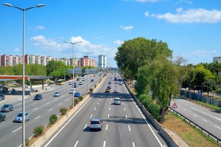 HOSPITALET DE LLOBREGAT, SPAIN - SEPTEMBER 2, 2017: A view of the Granvia avenue in Hospitalet de Llobregat, Spain, as it passes through Bellvitge district, towards the city of Barcelona