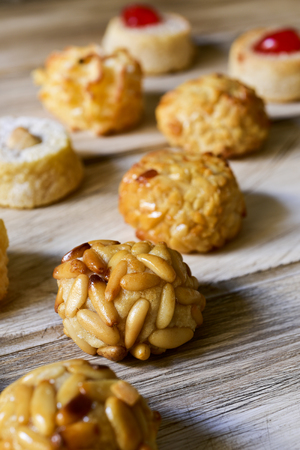 closeup of some panellets, typical confection eaten in All Saints Day in Catalonia, Spain, on a wooden table Stock Photo