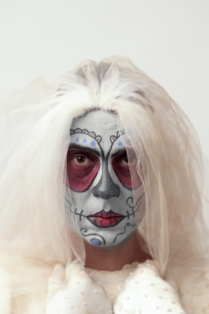 terrifying: portrait of a bride with a mexican calaveras makeup, wearing veil Stock Photo