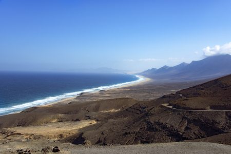 a panoramic view of the southwestern coast of the natural park of Jandia, in Fuerteventura, Canary Islands, Spain, highlighting the lonely Cofete Beach Stockfoto