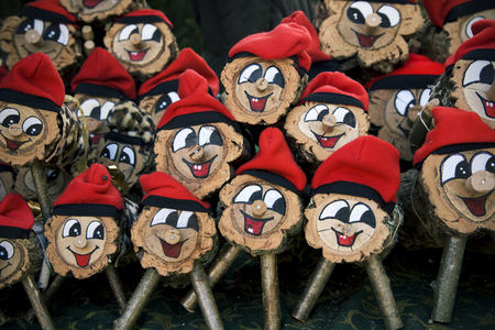 some handmade tio de nadal, a typical christmas character of catalonia, spain, on sale in a christmas market Banco de Imagens - 91181132