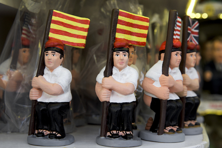 some caganer, a typical catalan character in the nativity scenes of catalonia, spain, depicting a catalan peasant defecating, on sale in a stall of a christmas market Stock Photo