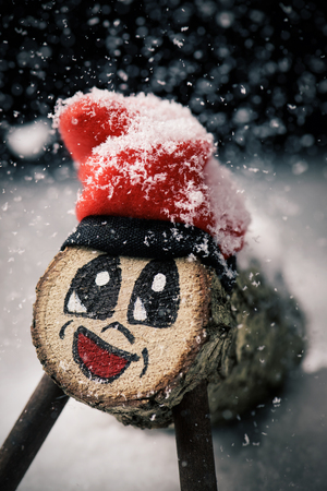 a handmade tio de nadal, a typical christmas character of catalonia, spain, on the snow