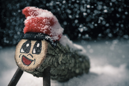 a handmade tio de nadal, a typical christmas character of catalonia, spain, on the snow Banco de Imagens - 91509962