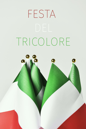 some flags of italy and the text festa del tricolore, tricolor day in italian, the day of the italian flag Banque d'images