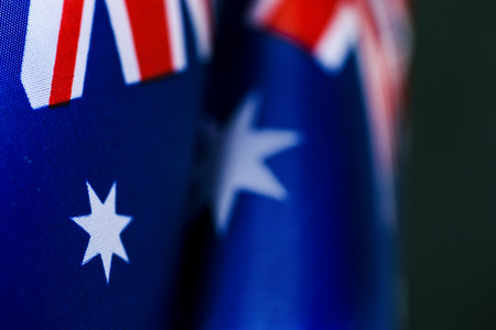 closeup of some australian flags against a dark green background Banque d'images