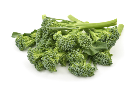 closeup of some stems of broccolini on a white background