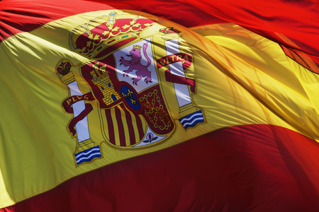 the flag of spain waving on the wind Stock Photo
