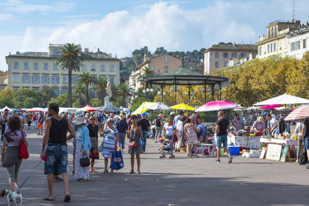 BASTIA, FRANCE - SEPTEMBER 16, 2018: People buying on a street market installed every Sunday on the Place Saint-Nicolas square in Bastia, Corsica, France Editorial