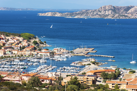 A panoramic view over Palau, in Sardinia, Italy, with its marina in the foreground