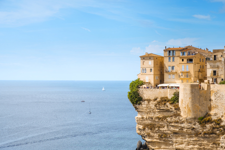 BONIFACIO, FRANCE - SEPTEMBER 19, 2018: A view of the Haute Ville, the old town of Bonifacio, in Corse, France, built on the top of a promontory next to a cliff over the Mediterranean sea Editorial