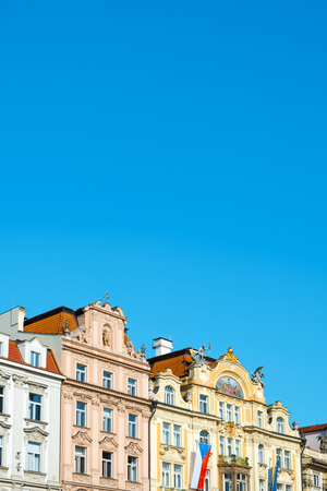 closeup of the top section of some ancient buildings in the old town of Prague, in the Czech Republic, with a blank space in the blue sky above Reklamní fotografie