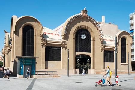TARRAGONA, SPAIN - SEPTEMBER 23, 2018: A view of the main facade of the historical Central Public Market of Tarragona, and the Corsini Square, in Tarragona, Spain Editorial