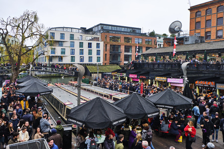 LONDON, UK - DECEMBER 30, 2018: Visitors at Camden Lock. Camden Lock, Camden Market, and streets nearby are the fourth-most popular attraction in the city, attracting 100,000 people each weekend