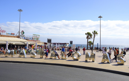 MASPALOMAS, SPAIN - JANUARY 23, 2019: A view of the promenade of Playa del Ingles, in Maspalomas, Gran Canaria, in the Canary Islands, Spain, a popular winter beach destination for European people 에디토리얼