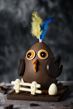 closeup of a funny chocolate chick as a Spanish Mona de Pascua, a traditional confection given by godparents to godchild on Easter and typically eaten on Easter Monday