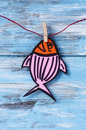 a homemade paper fish, made by myself, as a popular prank for april fools day in countries such as Italy, France, Belgium, Netherlands, Switzerland or Canada hanging from a rope with a clothespin